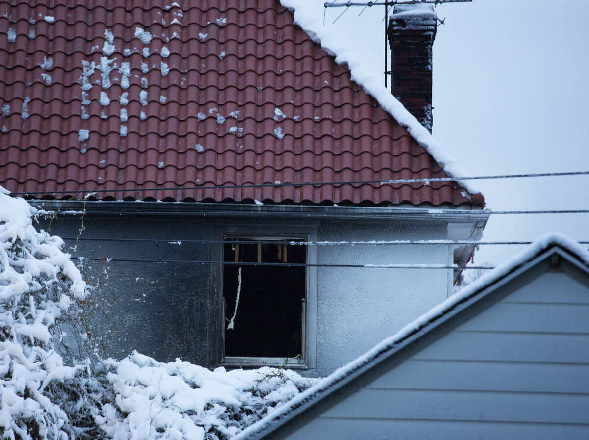 Damage can be seen along an upper floor on the back of a house at the scene of a fire in which seven children died in the Brooklyn borough of New York Saturday, March 21, 2015. (AP Photo/Craig Ruttle)