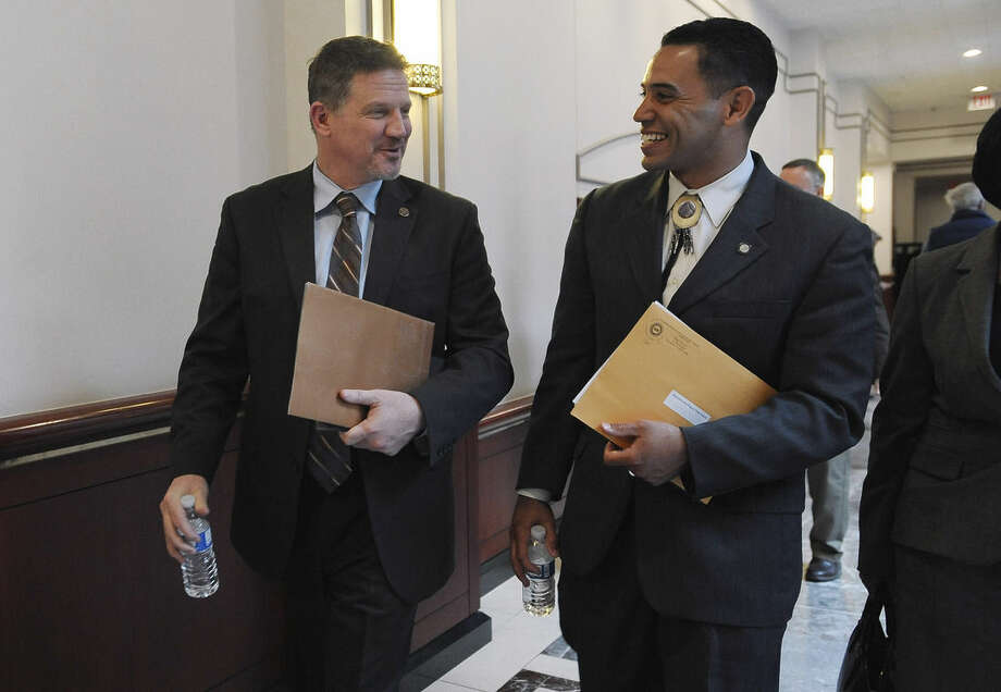 Kevin Brown, chairman of the Mohegan Tribe, left, and Rodney Butler, chairman of the Mashantucket Pequot Tribal Nation leave a hearing at the Legislative Office Building, Tuesday, March 17, 2015, in Hartford, Conn. The chairmen of Connecticut's two federally recognized Indian tribes testified, warning lawmakers that a new casino in neighboring Springfield, Massachusetts, could cost the state as many as 18,000 jobs unless steps are taken to address the competition. Brown and Butler said in an interview with The Associated Press that the tribes are rallying around the threat of new competition from Massachusetts casinos. (AP Photo/Jessica Hill)