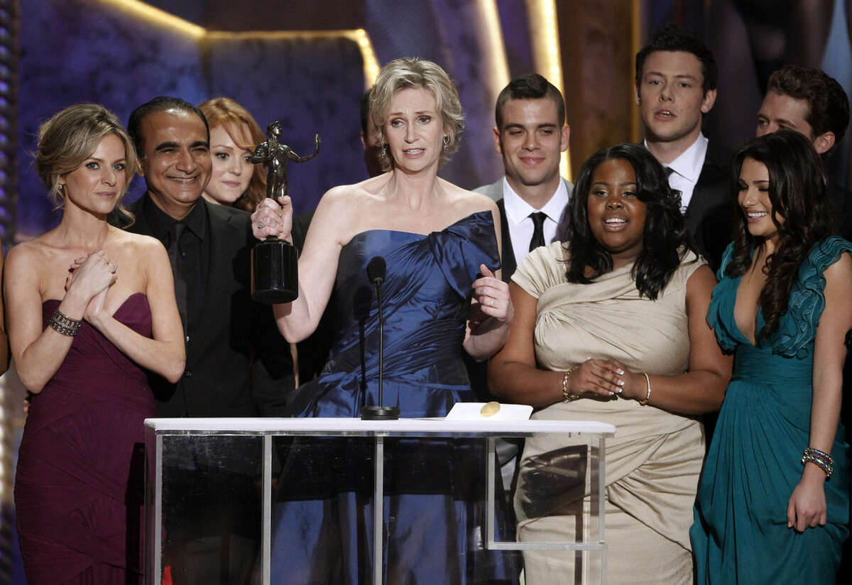 """FILE - In this Jan. 23, 2010 file photo, Jane Lynch, center, and the cast of """"Glee"""" accept the award for best ensemble in a comedy series at the 16th Annual Screen Actors Guild Awards in Los Angeles. """"Glee"""" will conclude its six-season run with a two-hour finale on Friday, March 20, 2015. (AP Photo/Mark J. Terrill)"""