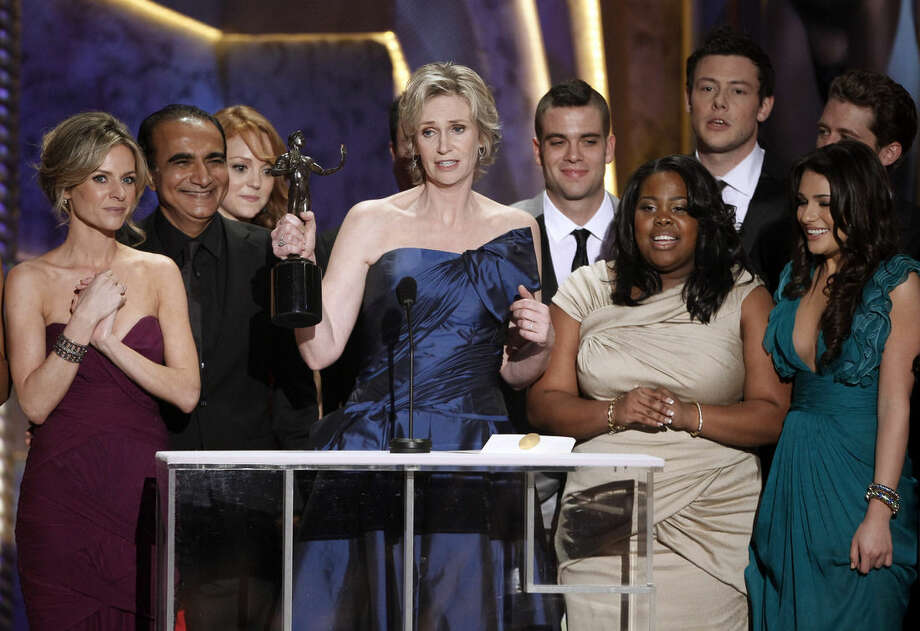 "FILE - In this Jan. 23, 2010 file photo, Jane Lynch, center, and the cast of ""Glee"" accept the award for best ensemble in a comedy series at the 16th Annual Screen Actors Guild Awards in Los Angeles. ""Glee"" will conclude its six-season run with a two-hour finale on Friday, March 20, 2015. (AP Photo/Mark J. Terrill)"
