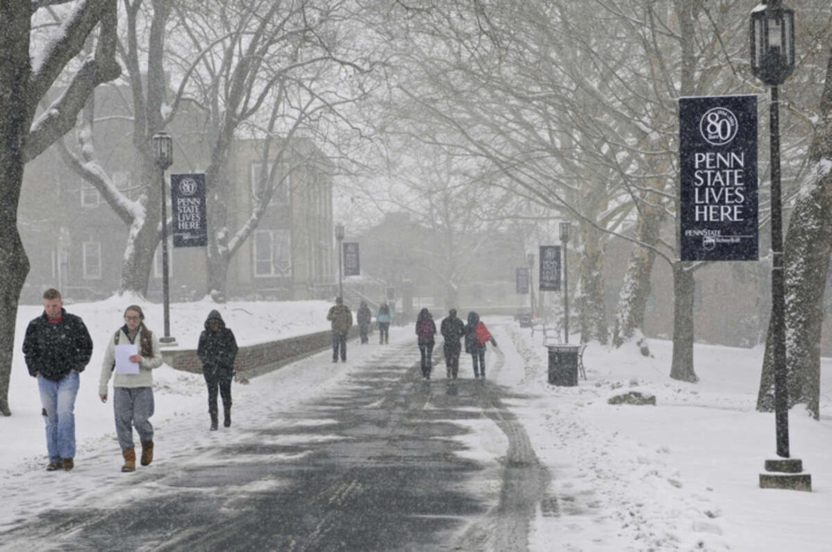 Students brave the elements at Penn State Schuylkill Campus in Schuylkill Haven, Pa., Friday, March 20, 2015. Forecasters say a storm will dump up to 6 inches of snow on the Northeast and mid-Atlantic on Friday. New England will be on the lower end of the snow totals but even Boston, which has seen a record 108.6 inches of snow, could get an inch or more. (AP Photo/Republican-Herald, Jacqueline Dormer)