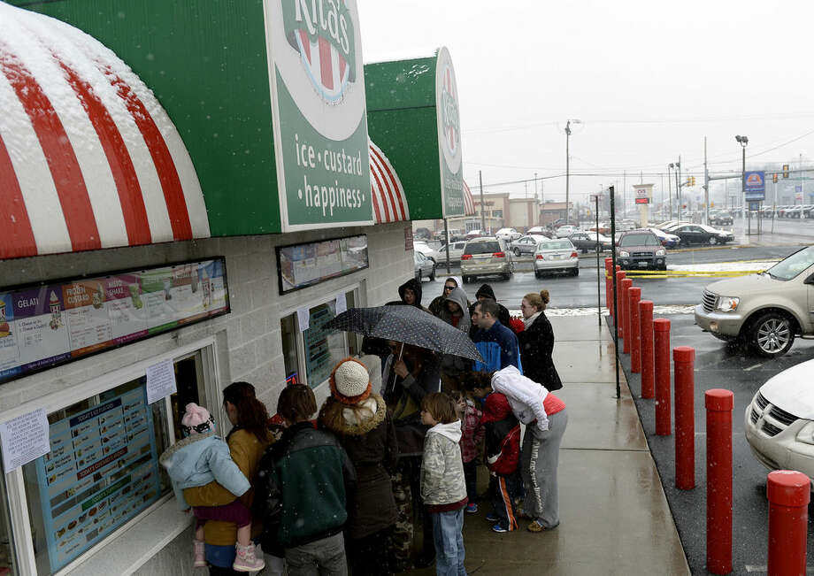 People wait in line at Rita's Italian Ice in Palmyra, Pa., Friday March 20, 2015. On the first day of Spring each year Rita's offers a free cup of the flavored ice to customers. (AP Photo/Lebanon Daily News, Jeremy Long) THE PATRIOT-NEWS OUT