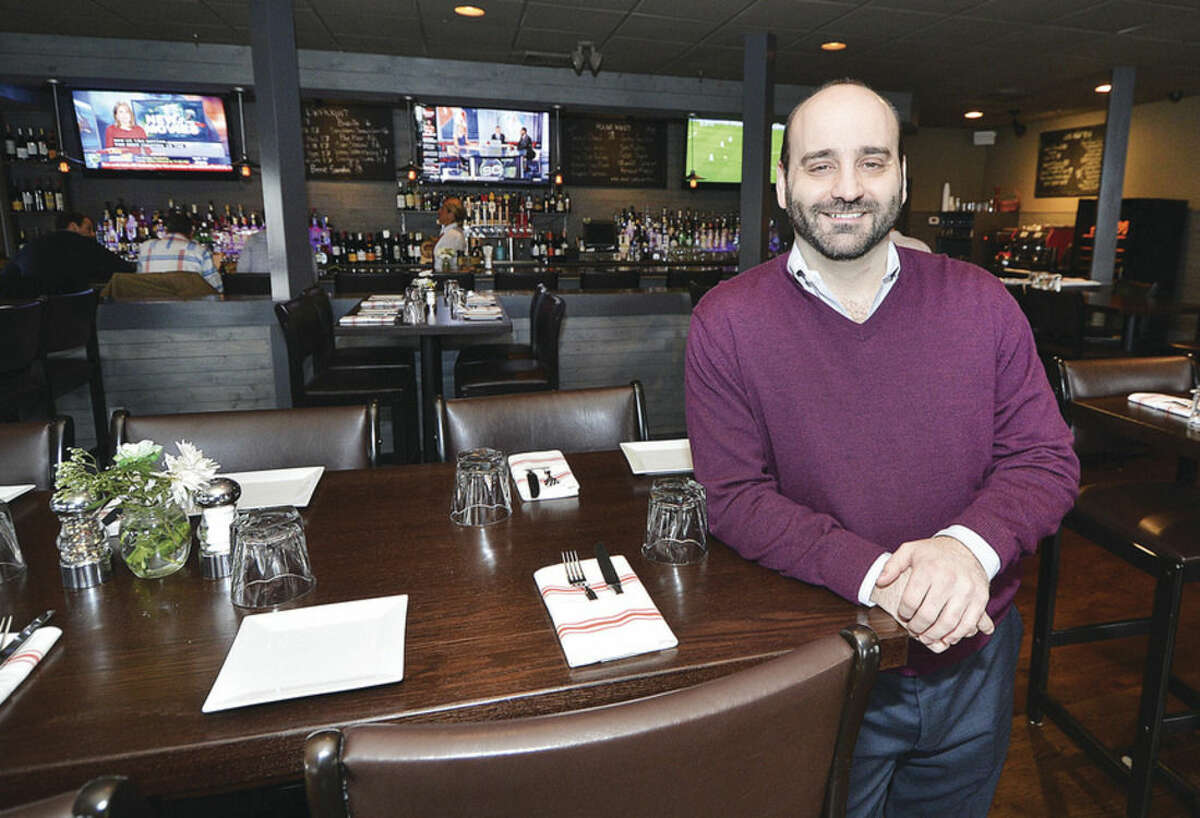 Hour Photo/Alex von Kleydorff Chris Gavrielidis, one of the owners of The Station House Bar and Grille at 232 East Ave Norwalk