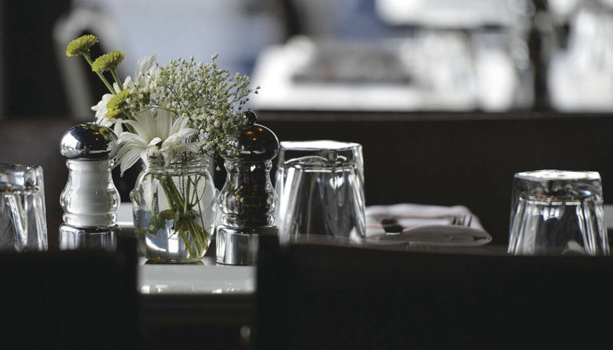 Hour Photo/Alex von Kleydorff Fresh flowers on the tables at The Station House Bar and Grille at 232 East Ave Norwalk