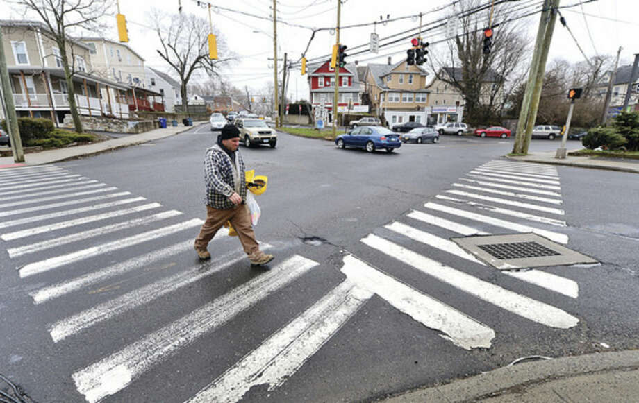 Hour photo / Erik Trautmann The Norwalk Department of Public Works is holding informational meeting April 22 on forthcoming replacement of 10 traffic signals and related pedestrian improvements along key arteries in Norwalk including the intersection at Route 1 and Main St.