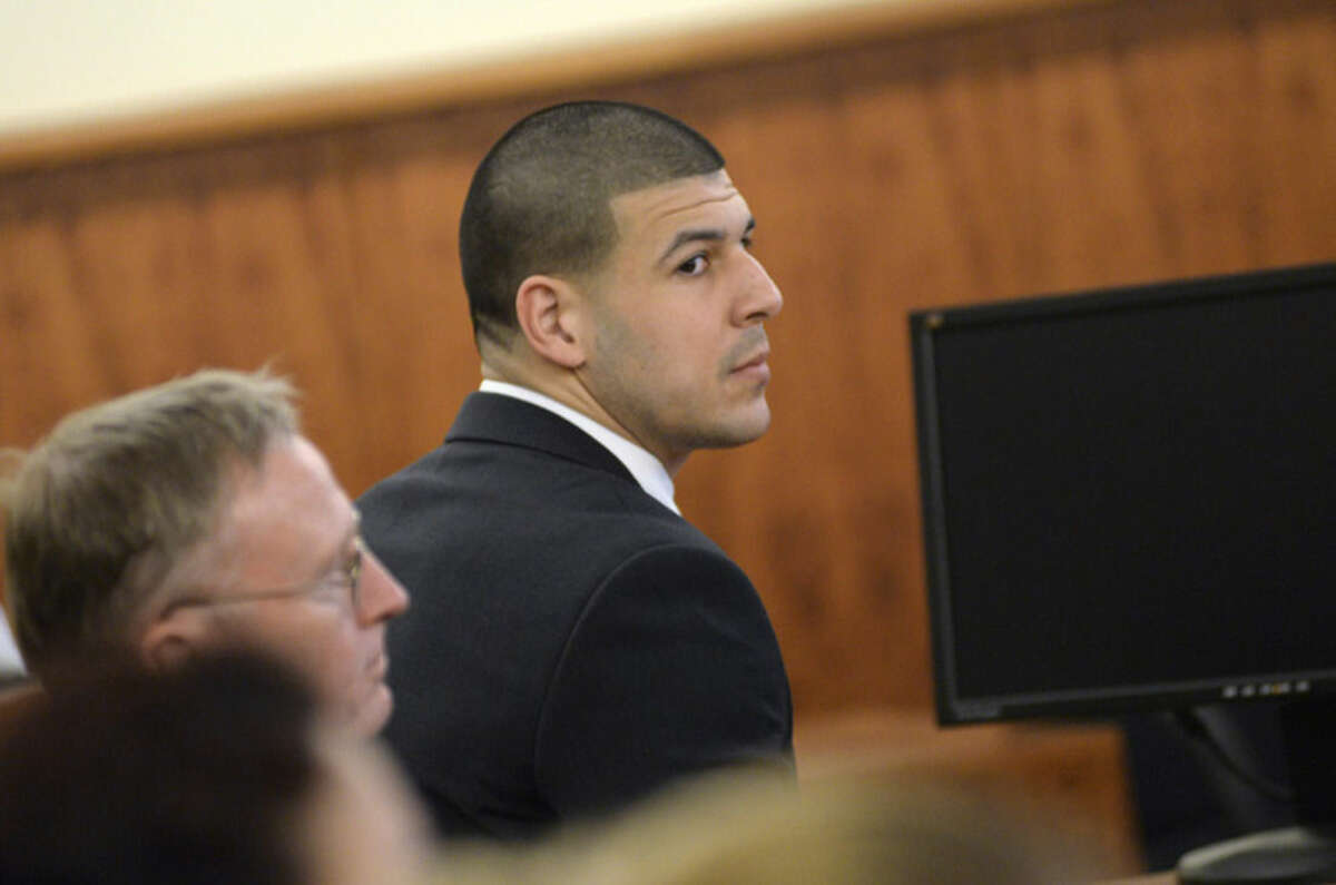 Former New England Patriots football player Aaron Hernandez, sits in the court room of the Bristol County Superior Court House in Fall River, Ma., before the jury begin their deliberations, Wednesday, April 8, 2015. Hernandez is accused of the murder of Odin Lloyd in June 2013. Today is the first day of jury deliberation. (AP Photo/Faith Ninivaggi, Pool)