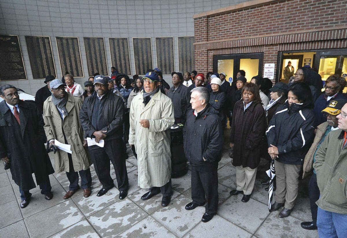 Hour photo/Alex von Kleydorff The Rev. Lindsay Curtis speaks with other local clergy during a rally in front of City Hall before the Board of Ed meeting Tuesday night.