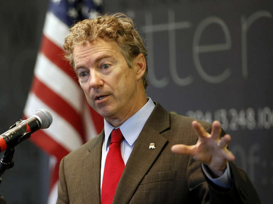FILE - In this March 20, 2015, file photo, Sen., Rand Paul, R-Ky. speaks in Manchester, N.H. Ready to enter the Republican chase for the party's presidential nomination this week, the first-term Kentucky senator has designs on changing how Republicans go about getting elected to the White House and how they govern once there. Paul will do so with an approach to politics that is often downbeat and usually dour, which just might work in a nation deeply frustrated with Washington. (AP Photo/Jim Cole, File)