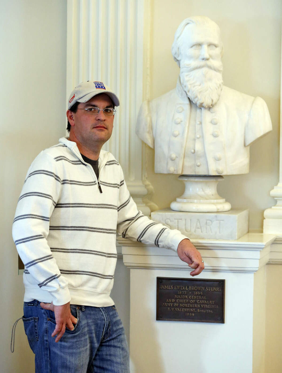FOR RELEASE SATURDAY, APRIL 4, 2015, AT 3:00 A.M. EDT- Civil War enthusiast Rob Orrison poses next to a bust of Confederate General J.E.B. Stuart, during a tour of the Old House chambers at the Capitol in Richmond, Va., Thursday, April 2, 2015. Orrison has been to 60-plus battlefields in four years during the Civil War's 150th anniversary which takes as much passion and commitment as getting married or having a child. (AP Photo/Steve Helber)