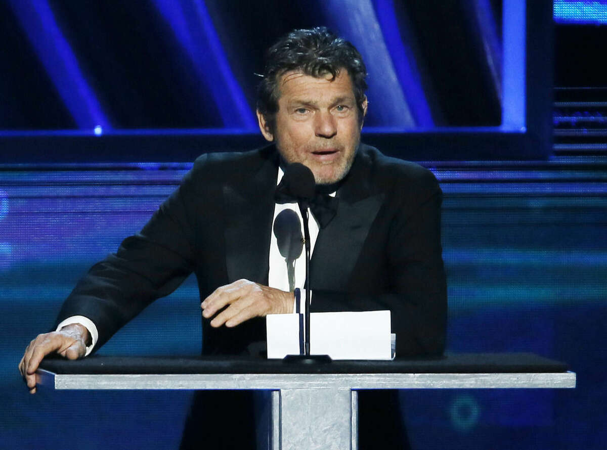 """FILE - In this April 18, 2013 file photo, Rock and Roll Hall of Fame chairman, and """"Rolling Stone"""" magazine editor and publisher, Jann Wenner, speaks during the Rock and Roll Hall of Fame Induction Ceremony in Los Angeles. Wenner, who founded the magazine as a 20-year-old college dropout, is weathering the stiffest test of Rolling Stone's credibility that the magazine has faced in its 48-year history. On Sunday, April 5, 2015, the magazine retracted last November's story on sexual assault at the University of Virginia in advance of the release of a damning Columbia University report about its reporting and editing, and on Monday, a fraternity named in the story threatened a lawsuit. (Photo by Danny Moloshok/Invision/AP, File)"""