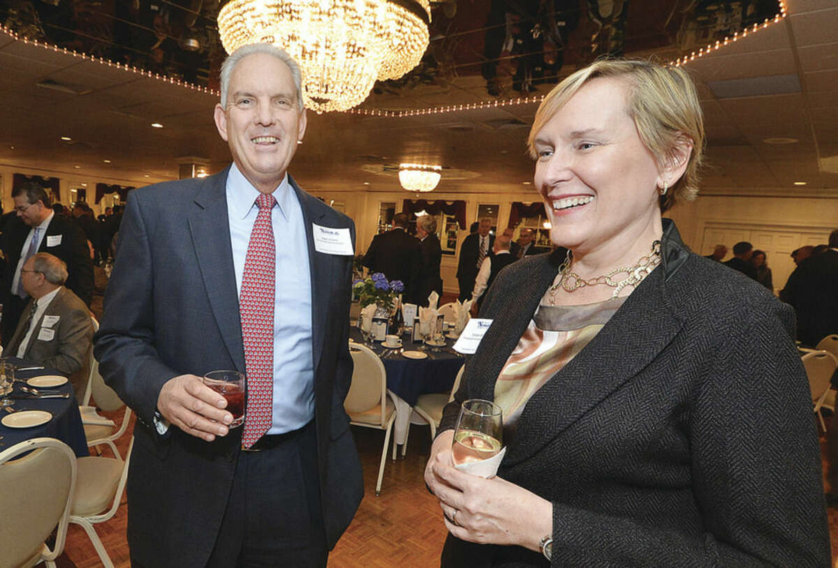 Hour Photo/Alex von Kleydorff Incomimg chairman Terry Polley and outgoing chairman Mike Sutton talks with guests during The Greater Norwalk Chamber of Commerce 126th Annual Dinner
