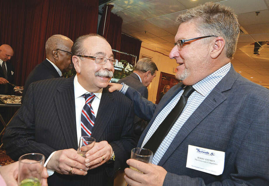Hour Photo/Alex von Kleydorff Jerry Effren and Lucien Sclafani talk during the cocktail reception at The Greater Norwalk Chamber of Commerce 126th Annual Dinner