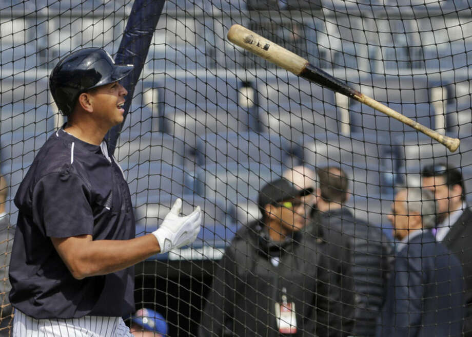 New York Yankees designated hitter Alex Rodriguez (13) tosses his bat after taking batting practice before an opening day baseball game against the Toronto Blue Jays in New York, Monday, April 6, 2015. (AP Photo/Kathy Willens)