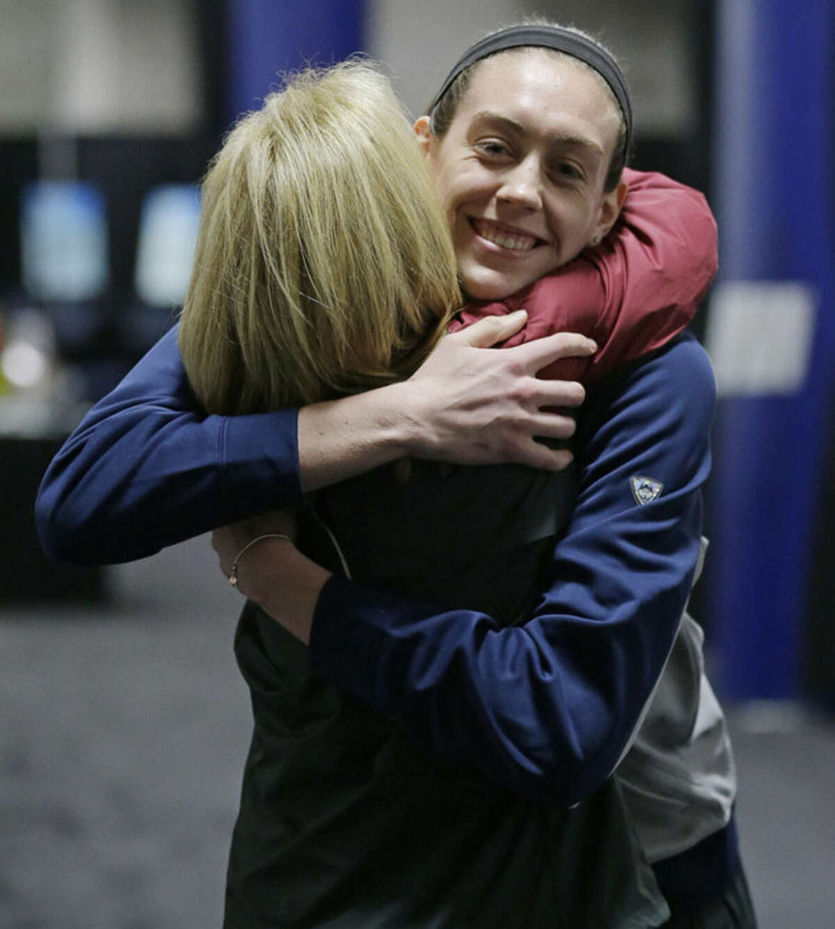 Connecticut forward Breanna Stewart embraces Florida State's Sue Semrau at the NCAA Final Four tournament, Saturday, April 4, 2015, in Tampa, Fla. UConn's versatile star earned The Associated Press Player of the Year award Saturday for the second consecutive year, becoming just the fifth player to do it. Florida State's Sue Semrau was selected as AP Coach of the year for the first time. (AP Photo/Chris O'Meara)