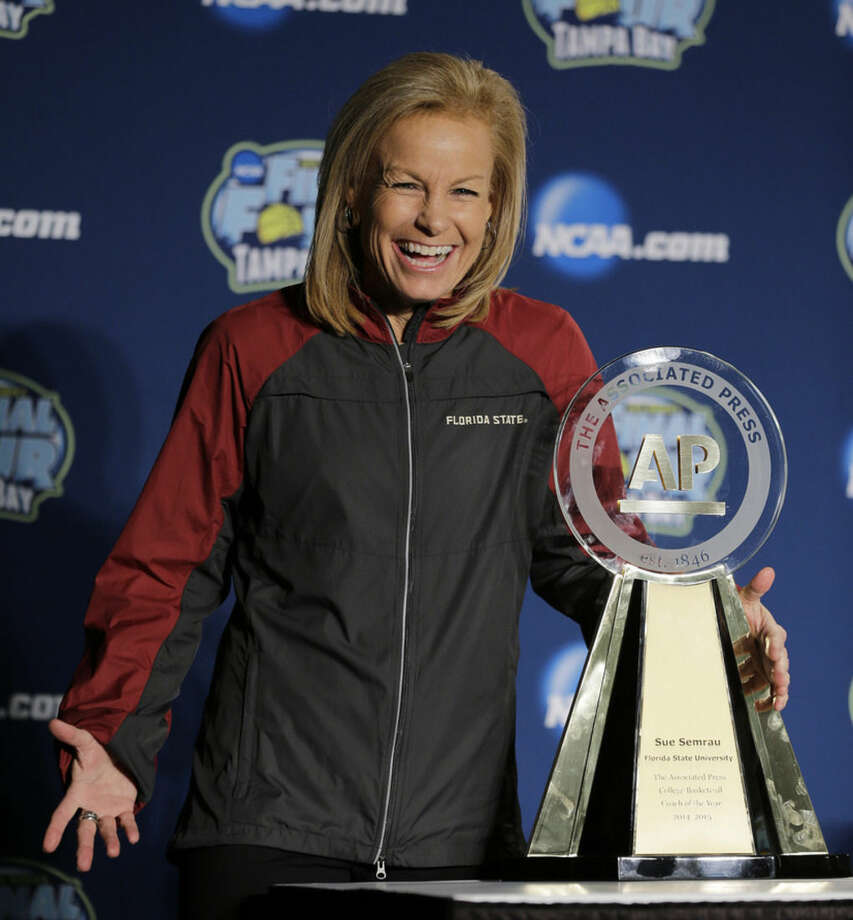 Florida State's Sue Semrau reacts to questions after receiving the Associated Press Coach of the Year award at the NCAA Final Four tournament, Saturday, April 4, 2015, in Tampa, Fla. Connecticut forward Breanna Stewart earned The Associated Press Player of the Year award Saturday for the second consecutive year and Semrau was selected as AP Coach of the year for the first time. (AP Photo/Chris O'Meara)