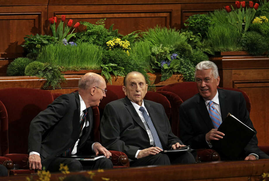 President Thomas S. Monson of The Church of Jesus Christ of Latter-day Saints, center, is flanked by President Henry B. Eyring, First Counselor in the First Presidency, left, and Dieter F. Uchtdorf, Second Counselor in the First Presidency during opening session of the two-day Mormon church conference Saturday, April 4, 2015, in Salt Lake City. More than 100,000 Mormons descended on Salt Lake City for the faith's biannual conference to listen to spiritual guidance from leaders and to learn about church news. (AP Photo/Rick Bowmer)