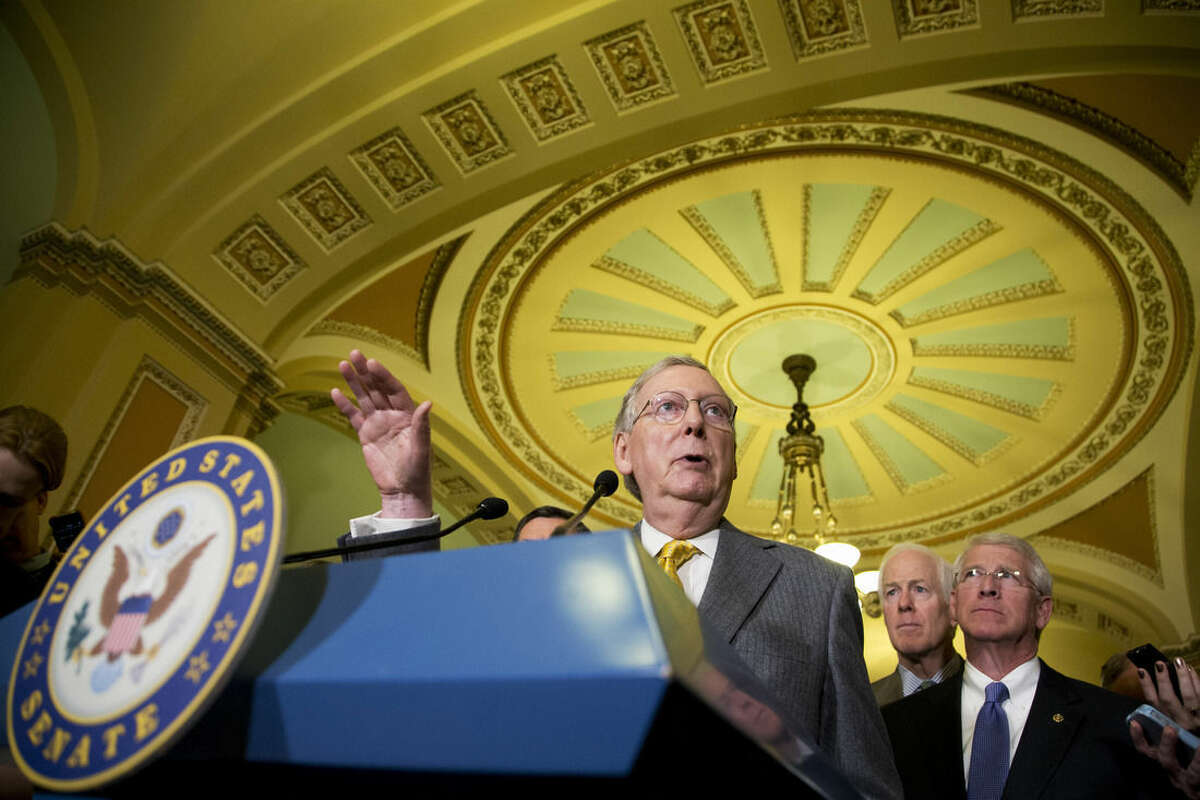 """In this April 14, 2015, photo Senate Majority Leader Sen. Mitch McConnell of Ky. speaks to reporters on Capitol Hill in Washington, Tuesday, April 14, 2015, following a Senate policy luncheon as Senate Majority Whip John Cornyn of Texas, and Sen. Roger Vicker, R-Miss., right, listen. Suddenly, bipartisanship has broken out on Capitol Hill. On Iran, Medicare, education and trade, Republicans and Democrats have come together to make deals, and that's something rarely seen lately. """"It's great,"""" Cornyn said after the Senate followed the House's lead this past week in overwhelmingly passing a bill overhauling the Medicare payment system for doctors. """"There's just a huge pent-up demand to actually get something done, on both sides."""" (AP Photo/Manuel Balce Ceneta)"""