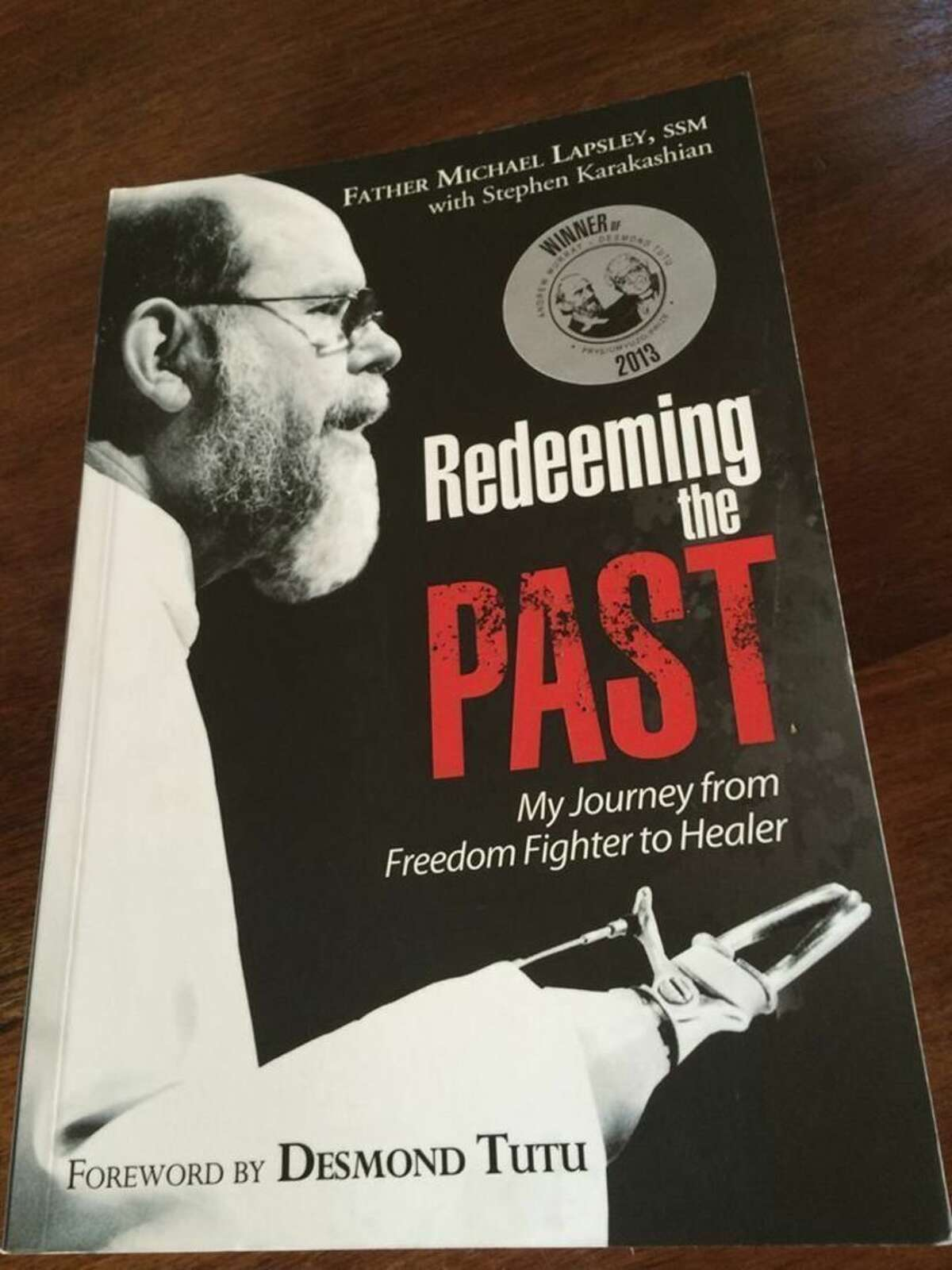 Contributed photo In 1990, Fr. Michael Lapsley, an Anglican priest active in the struggle against apartheid in South Africa, opened a letter bomb that nearly killed him, Though he survived, the blast took both his hands and one of his eyes. This memoir tells the story of this horrendous event, beginning with the journey that led him there particularly his rising awareness of the radical demands of the gospel and his growing identification with the freedom struggle. But that was not the end of his inspiring journey. In post-apartheid South Africa, Fr. Lapsley saw a whole nation in need of healing. He discovered a new vocation: drawing on his own experience of trauma to promote the healing of others, in South Africa, and ultimately throughout the world.