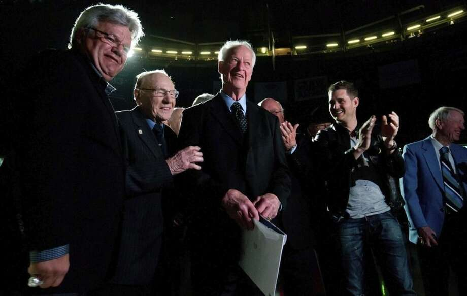 "FILE - In this March 1, 2013, file photo, Hall of Fame hockey player Gordie Howe, center, is joined by, from left, Marcel Dionne, Johnny Bower, Canadian singer Michael Buble and Jim Robson during an 85th birthday ceremony for Howe before the Vancouver Giants and Lethbridge Hurricanes WHL hockey game in Vancouver, British Columbia. An experimental stem cell treatment in Mexico late last year brought a ""life changing"" turnaround that's put the 87-year-old back Howe back on his feet after a significant stroke robbed him of the ability to walk and talk normally. (AP Photo/The Canadian Press, Darryl Dyck, File)"