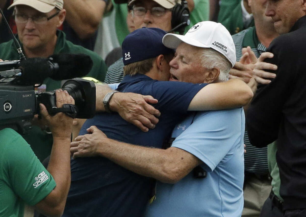 Jordan Spieth hugs his grandfather Bob after winning the Masters golf tournament Sunday, April 12, 2015, in Augusta, Ga. (AP Photo/Matt Slocum)