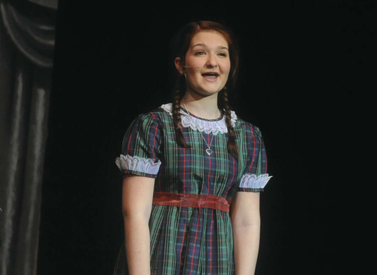 """Holly Rybnick sings """"The Sun will Come Out Tomorrow"""" as Annie in the dress rehearsal Tuesday at Norwalk High School."""