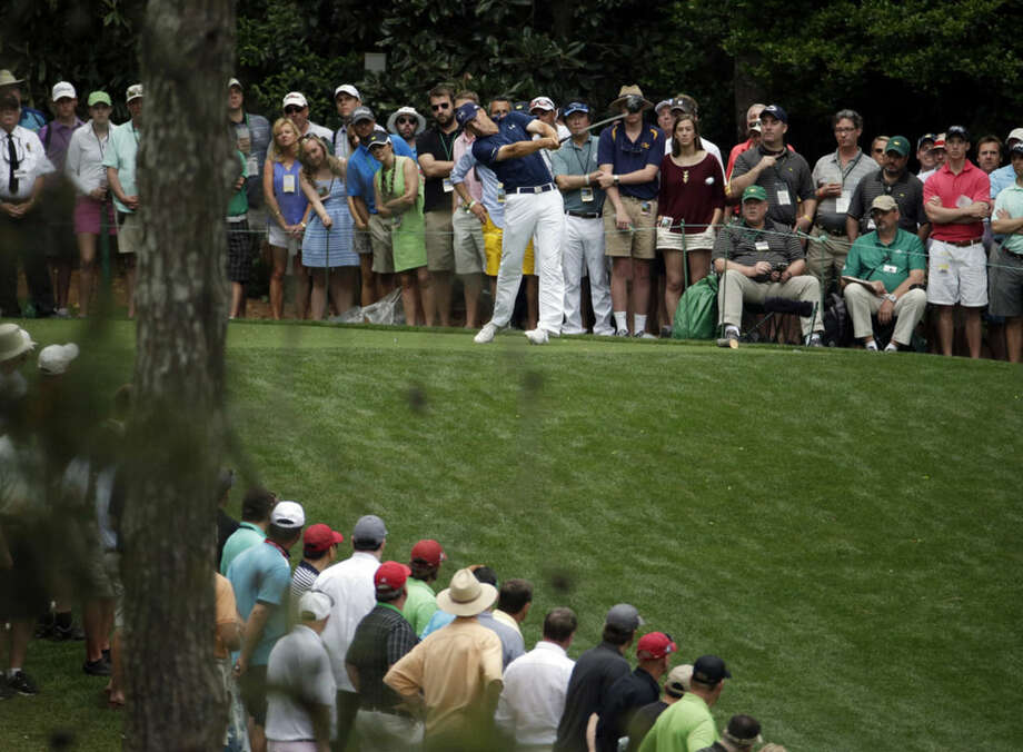 Jordan Spieth tees off on the 11th hole during the fourth round of the Masters golf tournament Sunday, April 12, 2015, in Augusta, Ga. (AP Photo/Charlie Riedel)