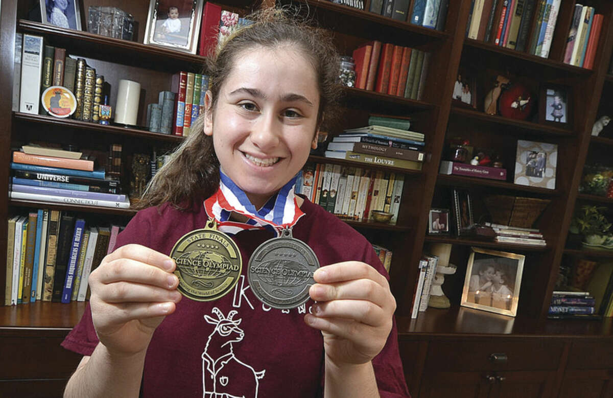 Hour Photo/Alex von Kleydorff Hopkins School Sophmore Emma Bucklan shows her Connecticut Science Olympiad medals