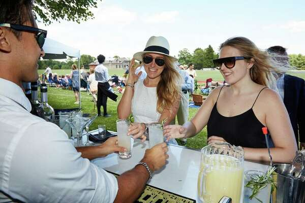 Fans at the Beluga Vodka tasting bar at the Greenwich Polo club on June 12, 2016.