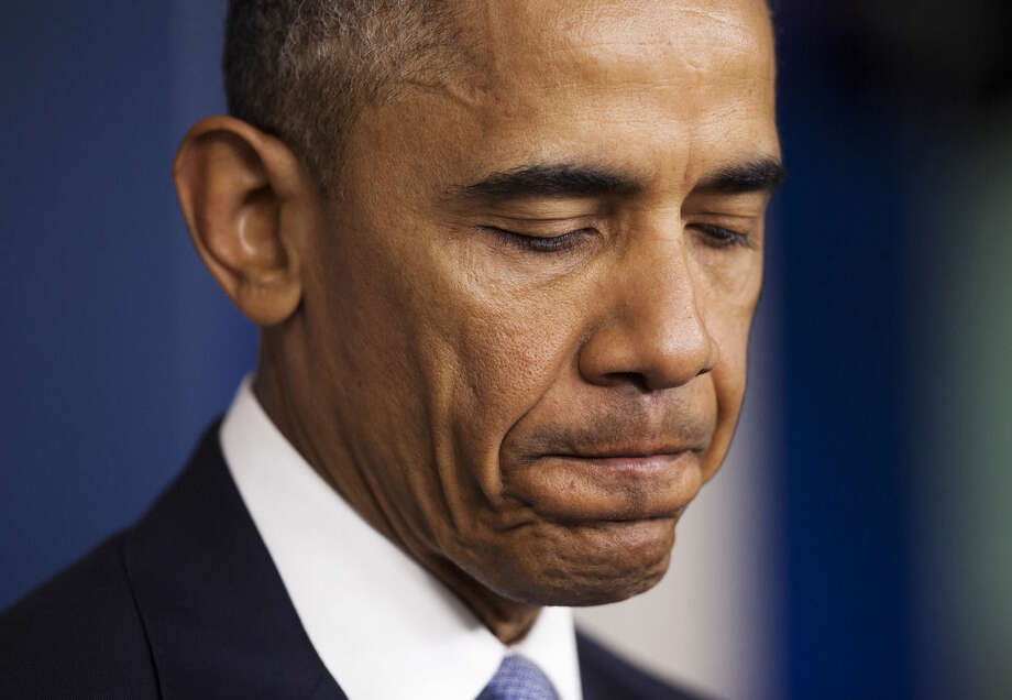 President Barack Obama pauses while speaking in the Brady Press Briefing Room of the White House in Washington, Thursday, April 23, 2015. The president took full responsibility for deaths of American, Italian hostages, expresses apologies. (AP Photo/Pablo Martinez Monsivais)