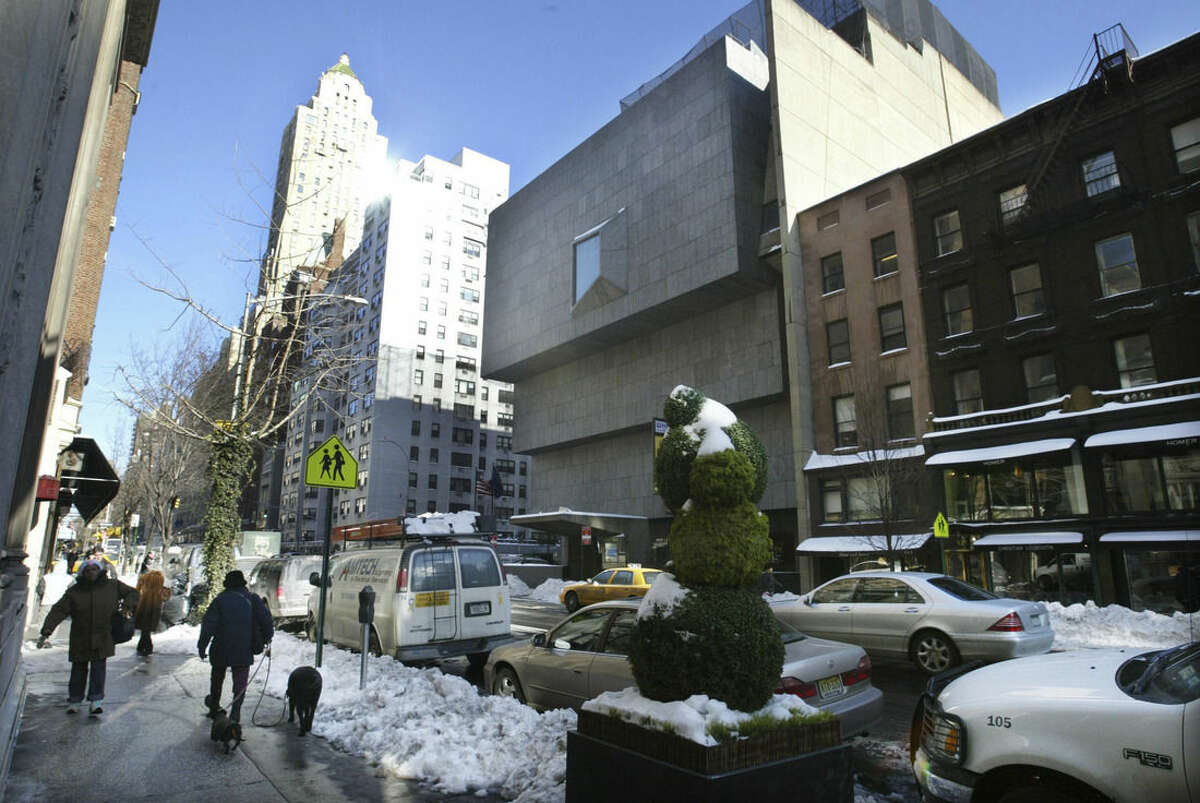 FILE - In this Jan. 25, 2005, file photo, the Whitney Museum of American Art, center, is shown on New York's Madison Avenue at 75th Street. The Whitney is opening its new facility May 1, 2015 in Manhattan's Meatpacking District, having leased its former home to the Metropolitan Museum of Art. (AP Photo/Bebeto Matthews, File)