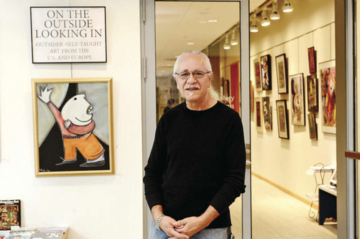 Hour photo / Erik Trautmann Phil Demise Smith, an artist, collector of Outsider Art, poet, writer, musician and teacher, curates his collection of Outsider Art exhibition at the Ridgefield Library's Gallery on the Lower Level. The exhibition will run through May 29.