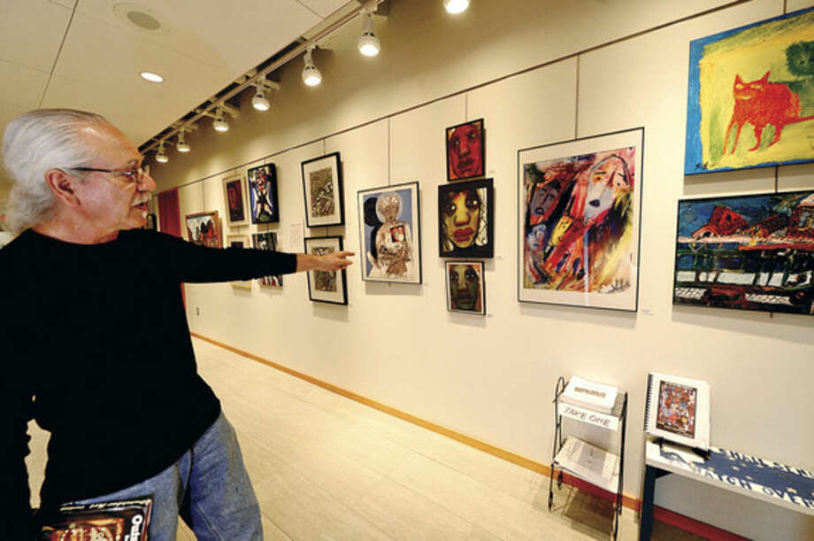 Hour photo / Erik TrautmannPhil Demise Smith, an artist, collector of Outsider Art, poet, writer, musician and teacher, curates his collection of Outsider Art exhibition at the Ridgefield Library's Gallery on the Lower Level. The exhibition will run through May 29.