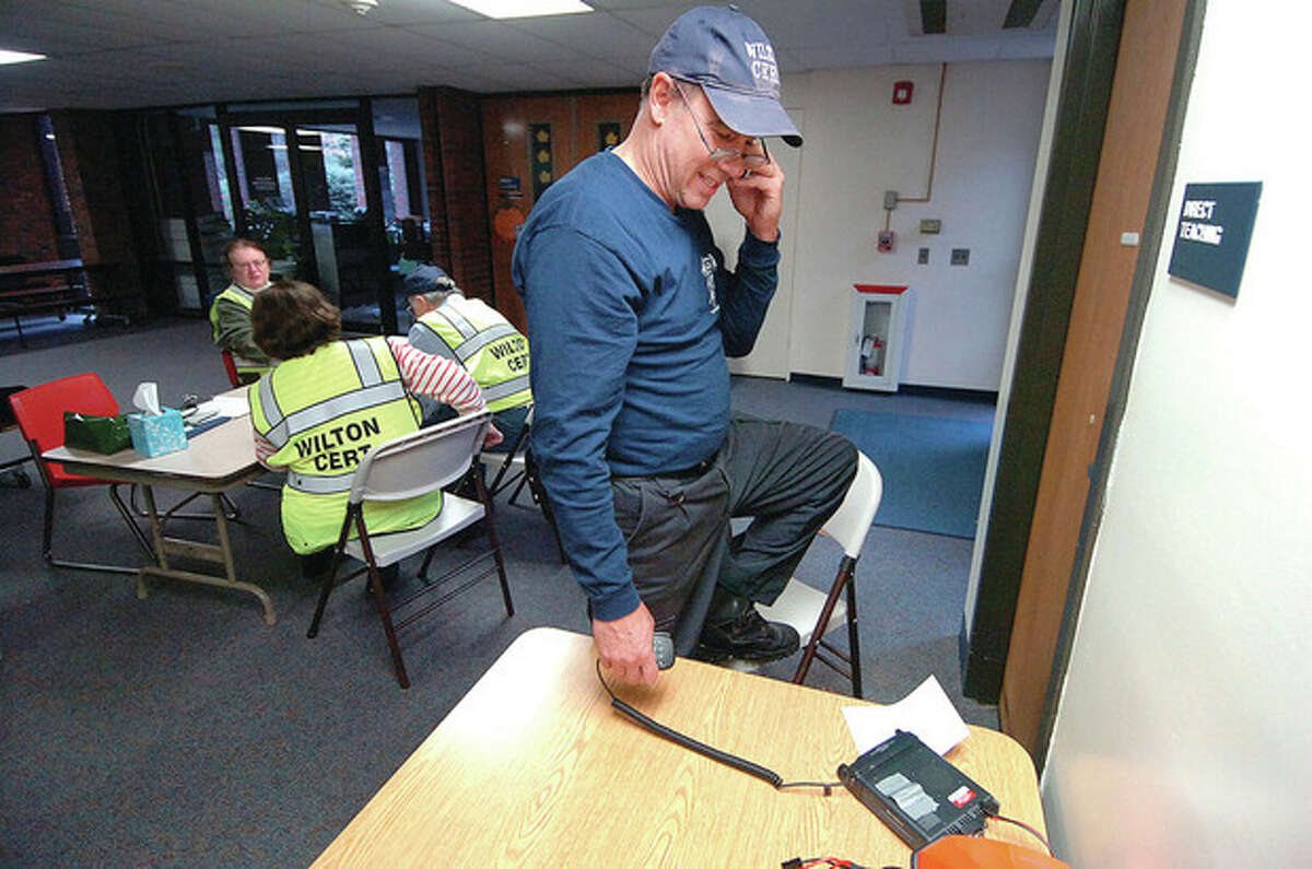 Wilton CERT member T.G. Rawlings perfoms a radio check at the shelter at Miller-Driscoll School in Wilton.