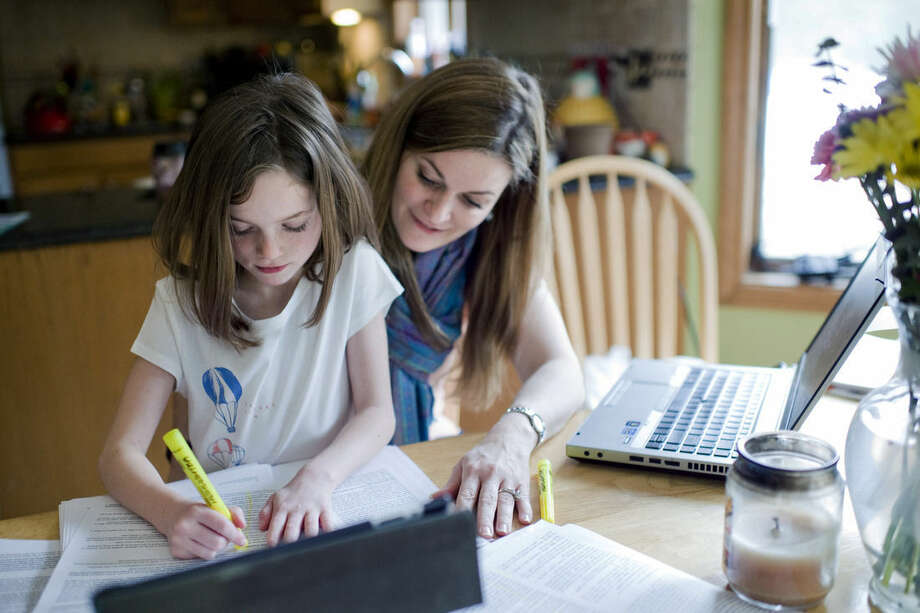 MEMBER FEATURE EXCHANGE ADVANCE FOR APRIL 12 -- In this April 3, 2015 photo, Kelly Howard works with her 7-year-old daughter Zoey, who has dyslexia, at their home in New Hartford, Conn. New legislation that went into effect in January adds a checkbox for dyslexia under students' individualized education plans, a step parents say will help schools focus on the disorder. (AP Photo/Republican-American, Erin Covey)