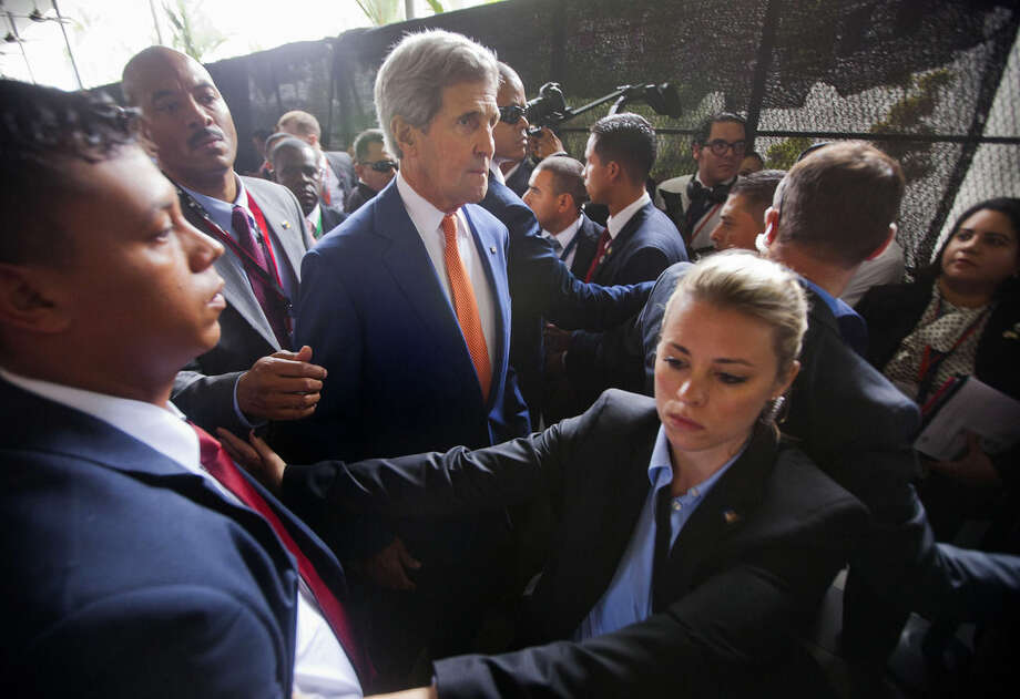 Secretary of State John Kerry makes his way through security to join President Barack Obama at a multi-lateral meeting with Central American Integration System (SICA) Presidents, Friday, April 10, 2015, in Panama City, Panama. Obama is in Panama to attend the VII Summit of the Americas. (AP Photo/Pablo Martinez Monsivais)