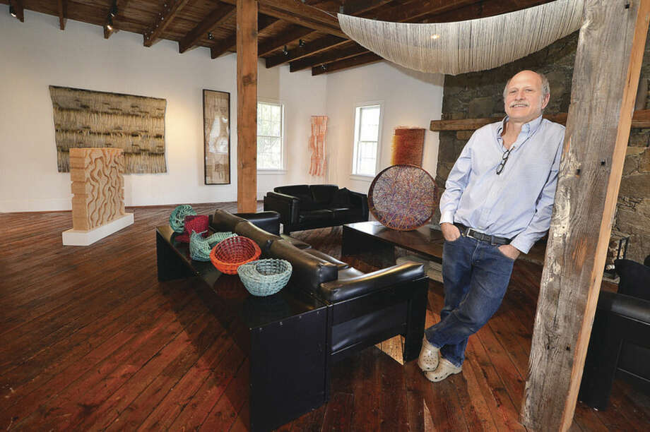 Hour Photo/Alex von KleydorffTom Grotta, co-curator of browngrotta arts, stands in one of the rooms in his gallery.