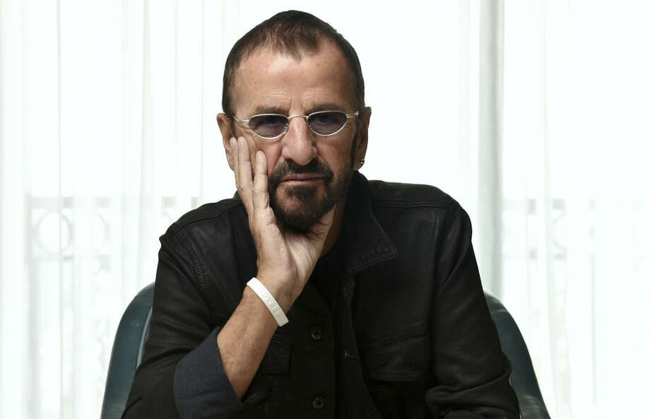 In this Monday, March 30, 2015 photo, Ringo Starr poses for a portrait at The London Hotel, in West Hollywood, Calif. Already a member of the Rock and Roll Hall of Fame as a Beatle, Starr will be inducted in April 2015, as an individual, joining John, Paul and George with that distinction. (Photo by John Shearer/Invision/AP)