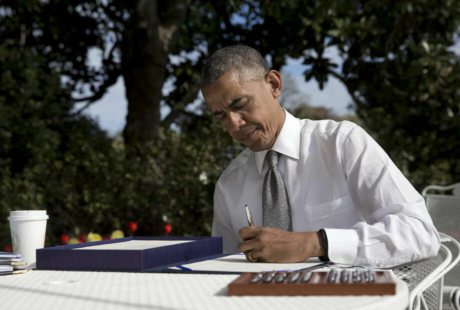 President Barack signs the bill H.R. 2 Medicare Access and CHIP Reauthorization Act of 2015, Thursday, April 16, 2015, in the Rose Garden of the White House in Washington. The president signed legislation permanently changing how Medicare pays doctors, a rare bipartisan achievement by Democrats and Republicans. The bill overhauls a 1997 law that aimed to slow Medicare's growth by limiting reimbursements to doctors. Instead, doctors threatened to leave the Medicare program, and that forced Congress repeatedly to block those reductions. (AP Photo/Carolyn Kaster)