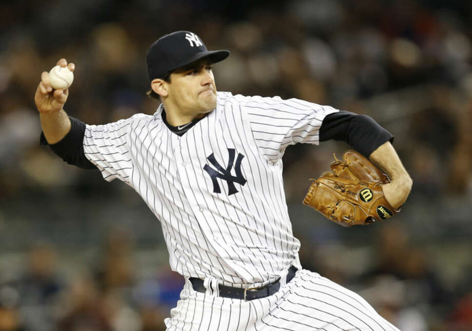 New York Yankees starting pitcher Nathan Eovaldi delivers in the first inning of a baseball game against the New York Mets at Yankee Stadium in New York, Sunday, April 26, 2015. (AP Photo/Kathy Willens)