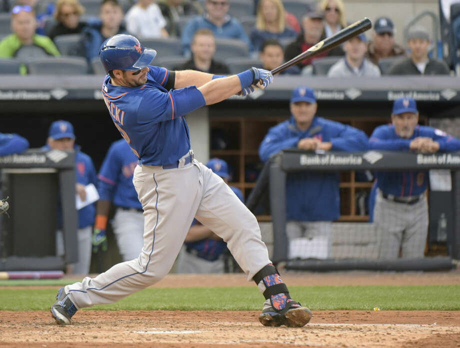 New York Mets' Kevin Plawecki hits a two-run home run during the fourth inning of an interleague baseball game against the New York Yankees Saturday, April 25, 2015, at Yankee Stadium in New York. (AP Photo/Bill Kostroun)