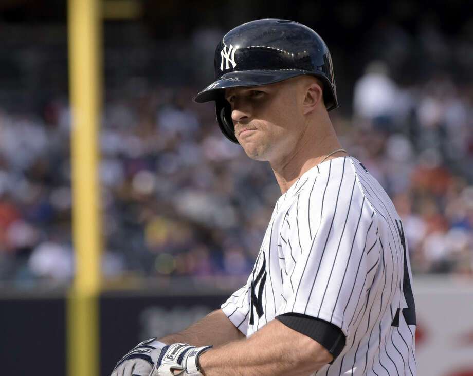 New York Yankees' Brett Gardner sports a mustache as he stands on first base after drawing a walk during the third inning of an interleague baseball game agains the New York Mets Saturday, April 25, 2015, at Yankee Stadium in New York. (AP Photo/Bill Kostroun)