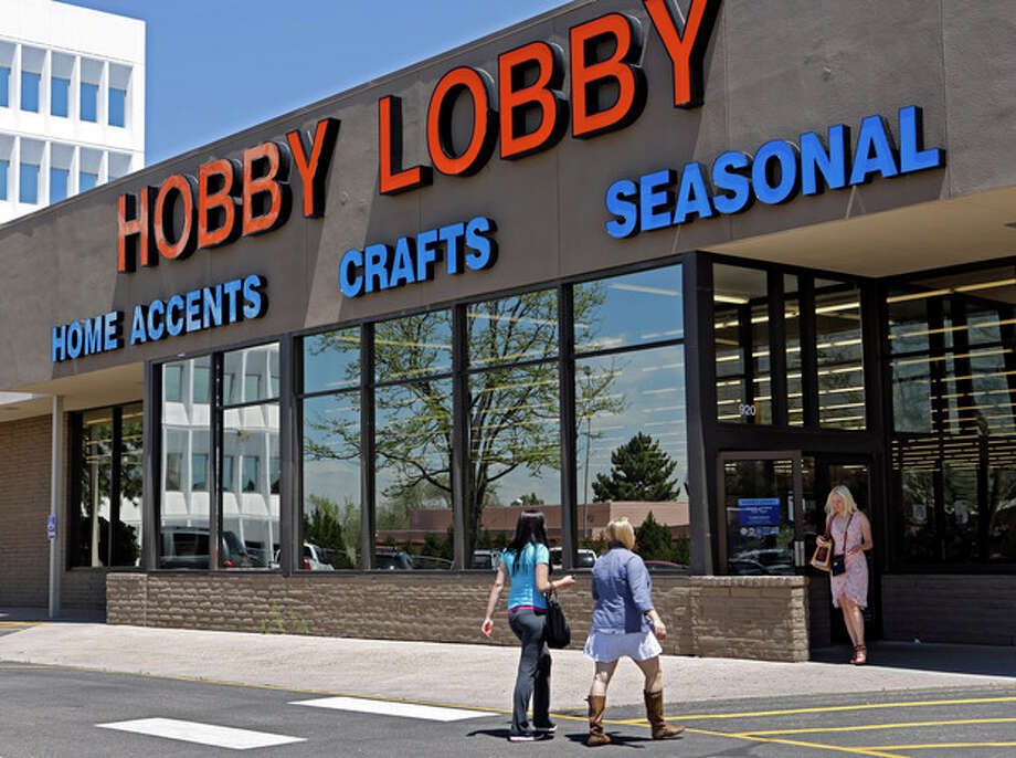 "FILE - This May 22, 2013 file photo shows customer at a Hobby Lobby store in Denver. President Barack Obama's health care law is headed for a new Supreme Court showdown over companies' religious objections to the law's birth-control mandate. The administration wants the court to hear its appeal of the Denver-based federal appeals court ruling in favor of Hobby Lobby, an Oklahoma City-based arts and crafts chain that calls itself a ""biblically founded business"" and is closed on Sundays. Founded in 1972, the company now operates more than 500 stores in 41 states and employs more than 13,000 full-time employees who are eligible for health insurance. The Green family, Hobby Lobby's owners, also owns the Mardel Christian bookstore chain. (AP Photo/Ed Andrieski, File) / AP"