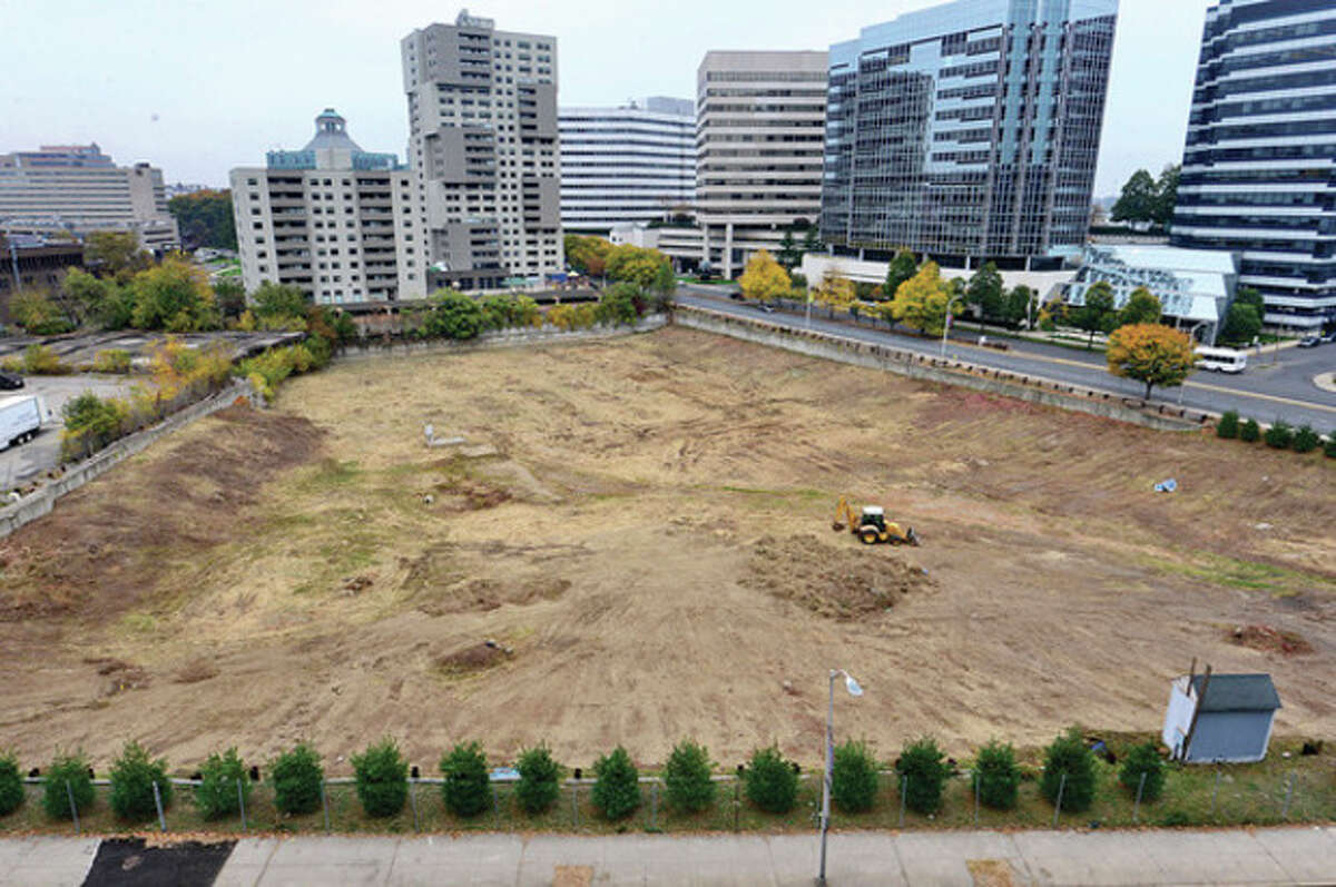 Hour photo / Erik Trautmann Mayor Michael A. Pavia held a press conference Thursday to announce a resolution to a decades-long land-use issue at Parcel #38 aka The Hole in the Ground.