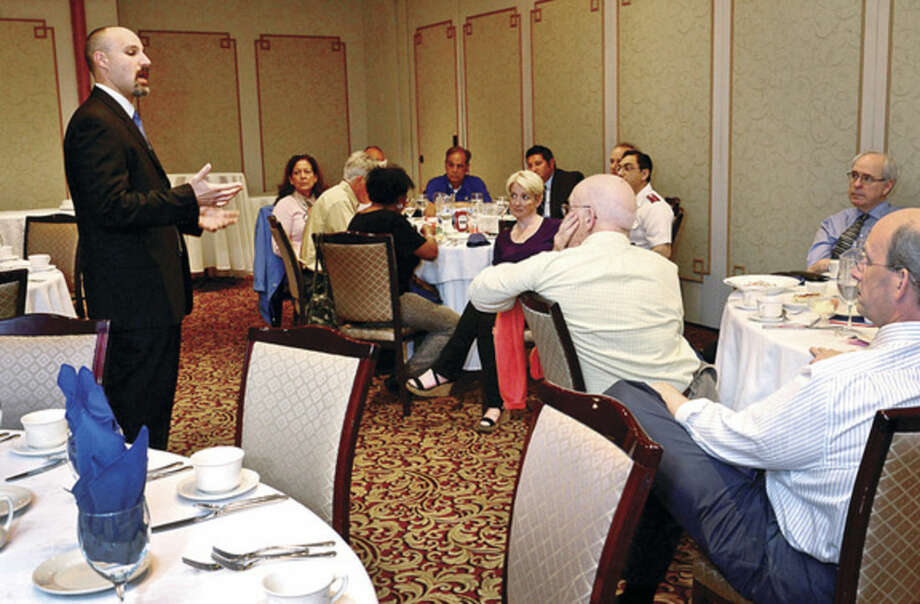 Hour photo / Erik TrautmannFBI agent, Bullets Campbell, addresses the Rotary Club during their luncheon at The Norwalk Inn Wednesday.