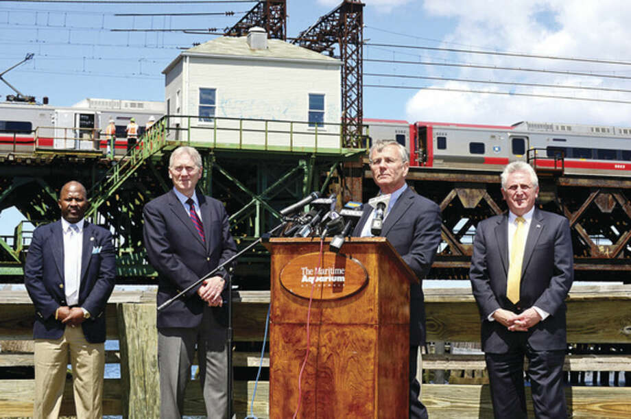 Hour photo / Erik Trautmann Local officials including Councilman TRavis Simms, CT Rail Commuter Council Vice Chairman, John Hartwell, DOT Commissioner, James Redeker, and Norwalk Mayor Harry Rilling, talk about the Walk Bridge during a press conference at the Maritime Aquarium Tuesday afternoon.