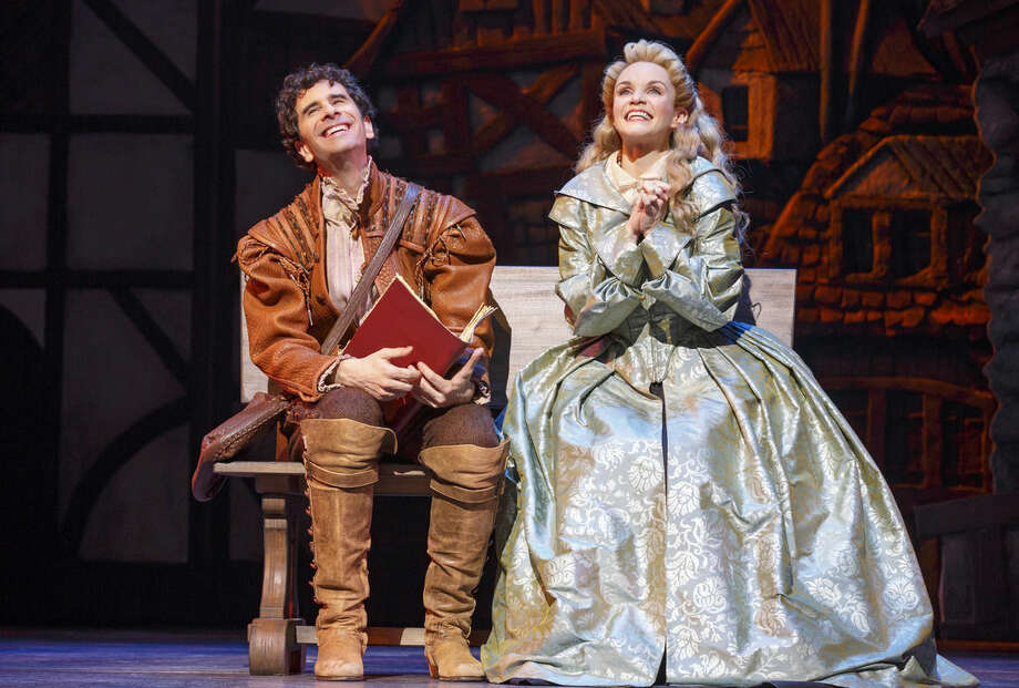 "This image released by Boneau/Bryan Brown shows John Cariani, left, and Kate Reinders during a performance of ""Something Rotten,"" in New York. (Joan Marcus/Boneau/Bryan Brown via AP)"