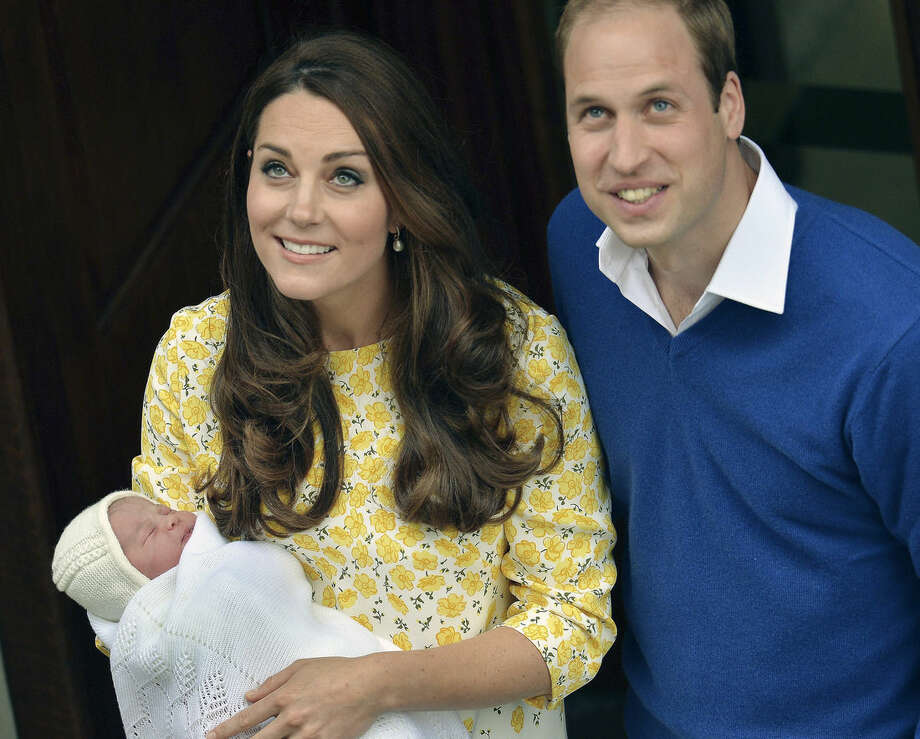 Britain's Prince William stands close to Kate, Duchess of Cambridge as she carries their newborn baby princess as they leave St. Mary's Hospital's exclusive Lindo Wing, London, Saturday, May 2, 2015. Kate, the Duchess of Cambridge, gave birth to their second child, a baby girl on Saturday morning. The name of the new born baby princess is not yet announced. (John Stillwell/Pool via AP)