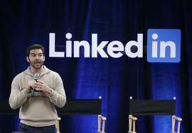 "FILE - In this Nov. 6, 2014, file photo, LinkedIn CEO Jeff Weiner speaks during the company's second annual ""Bring In Your Parents Day,"" at LinkedIn headquarters in Mountain View, Calif. Microsoft said Monday, June 13, 2016, it is buying professional networking service site LinkedIn for about $26.2 billion. LinkedIn, based in Mountain View, Calif., has more than 430 million members. (AP Photo/Marcio Jose Sanchez, File)"