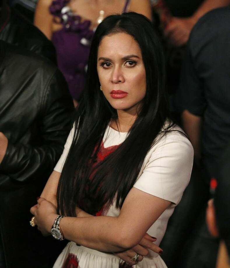Manny Pacquiao's wife, Jinkee, watches after Pacquiao lost his welterweight title fight against Floyd Mayweather Jr. on Saturday, May 2, 2015 in Las Vegas. (AP Photo/John Locher)