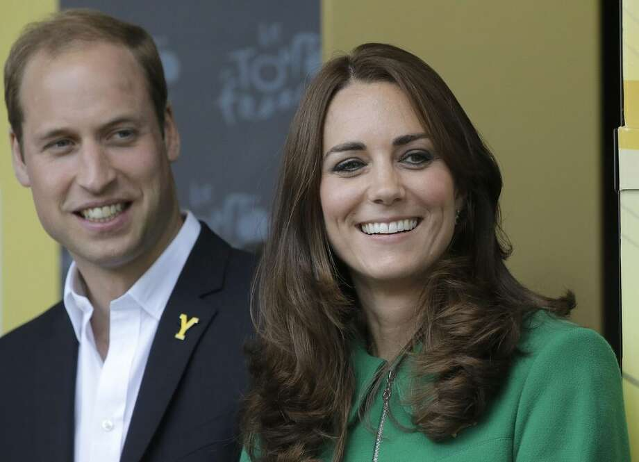 FILE - In this Saturday, July 5, 2014 file photo Kate, Duchess of Cambridge and Prince William watch the podium ceremony of the first stage of the Tour de France cycling race in Harrogate, England. Kensington Palace announced on Saturday May 2, 2015 that the Duchess of Cambridge has been admitted to hospital in the early stages of labor (AP Photo/Laurent Cipriani, File)